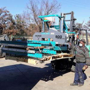 Rhino sawmill being loaded